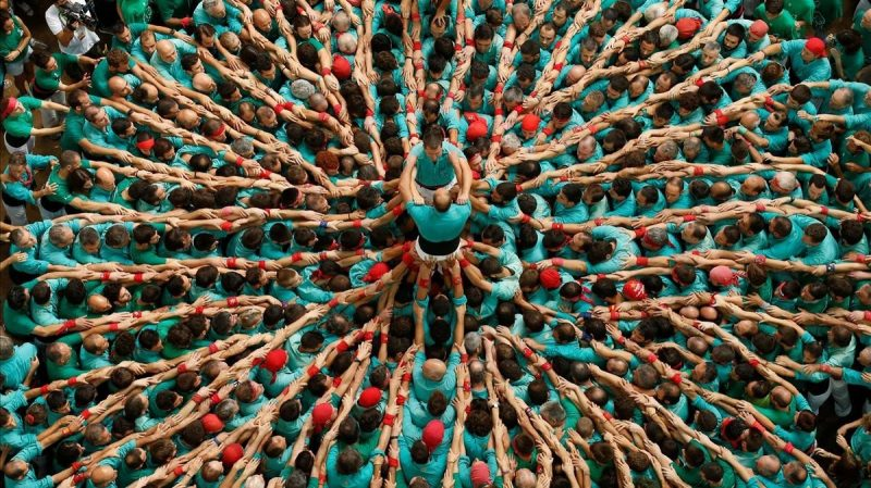 Castellers de Vilafranca start to form a human tower called castell during a biannual competition in Tarragona city.